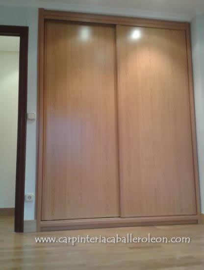 Armario de puertas correderas carpinter a caballero le n - Guias puertas correderas armarios empotrados ...